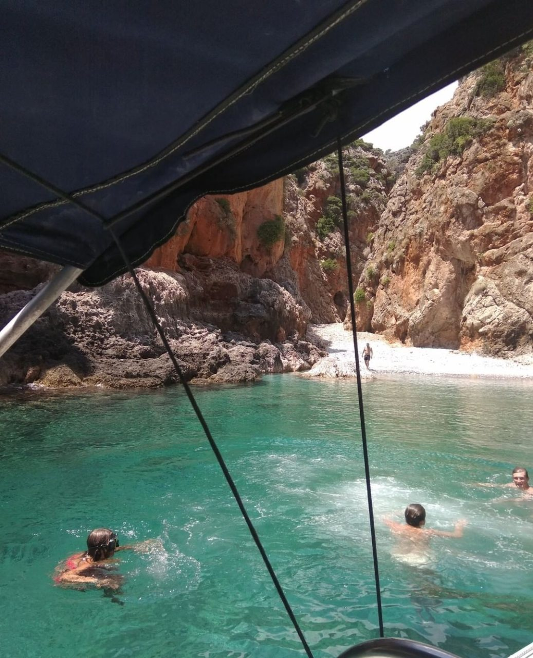 Rent a boat and visit the secret beaches of Crete